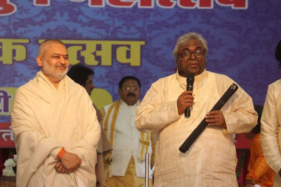 Pundit Amarnath Ji is presenting flute to Brahmachari Girish Ji