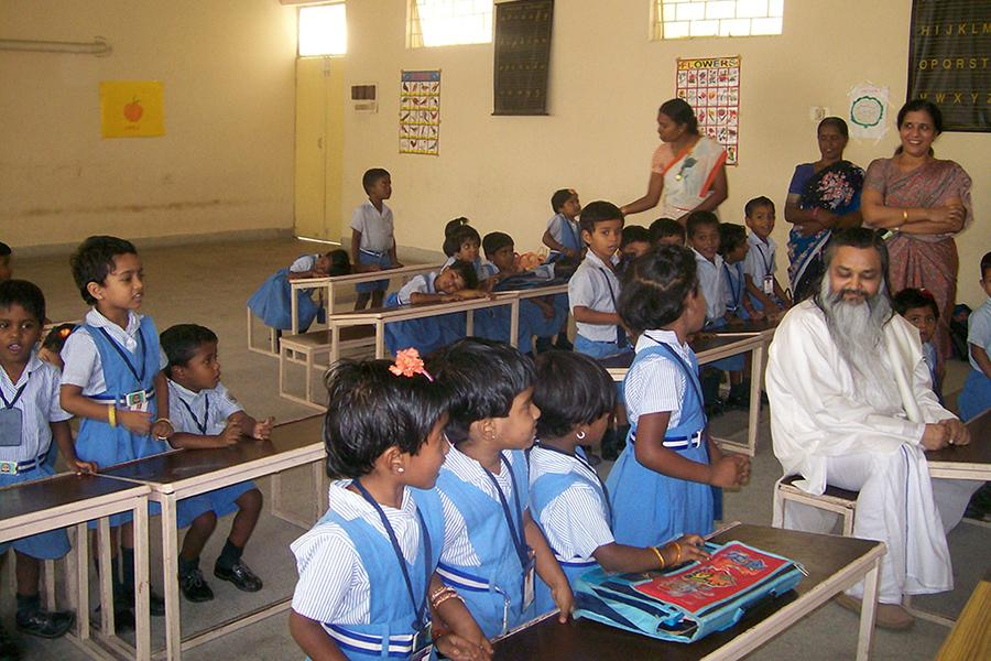 Brahmachari Girish Ji has visited Maharishi School of Excellence Chennai and interacted with Nursery class students. Year 2012