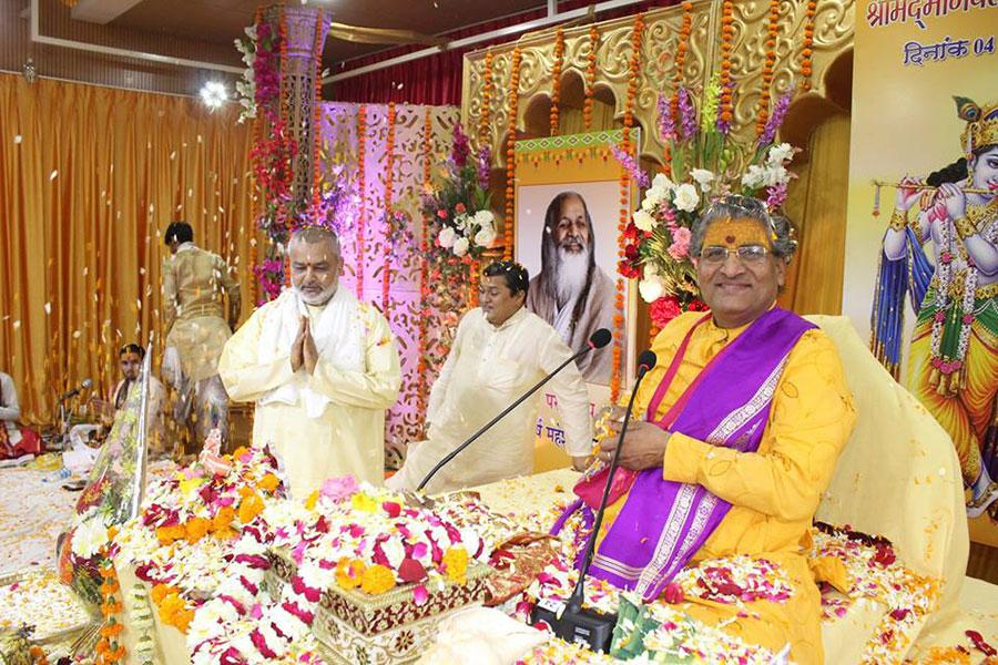 Brahmachari Dr. Girish Ji showered with flowers at Last Day - Katha Vishram Day of Shrimad Bhagwat Katha Amrit Pravah organised at Maharishi Utsav Bhawan of Gurudev Brahmanand Saraswati Ashram.