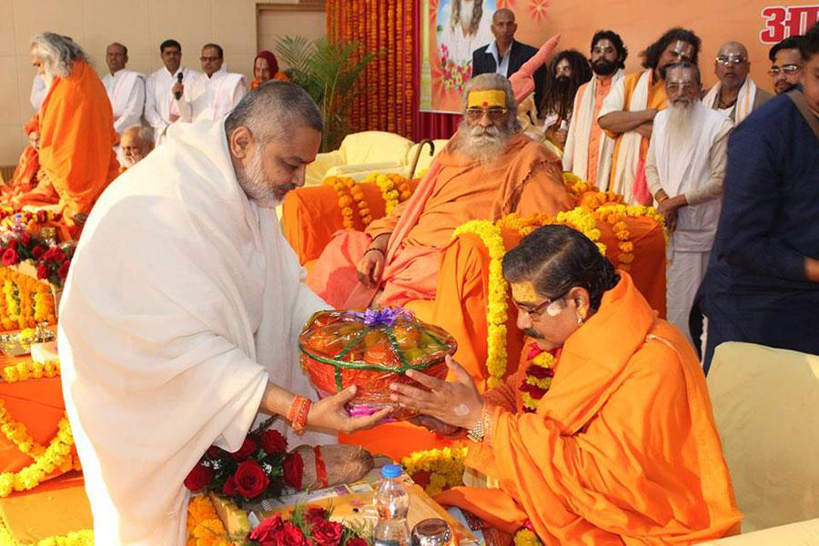 Brahmachari Shri Girish Ji is presenting fruits to Swami Jitendranath Ji during Maharishi Birth Centenary Year Fulfillment Celebration Bhopal